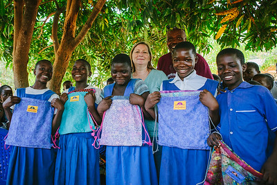 Many kids do not get to have something of their own.  They cannot afford to.  Top students receive their own, unique, bags to encourage them to continue with their schooling.
