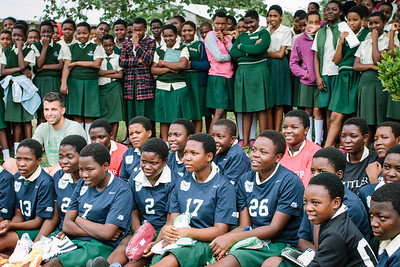 An all girls school is given full jerseys, shorts, socks, shoes, and balls.