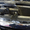 This is the only bolt that hold the grille on all the other fasteners are clips.  There are four clips on the front and