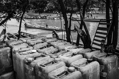 Containers with venezuelan gasoline that smuggles into Colombia trough the river. Puerto Santander, Colombia. Photo: Dany Krom.