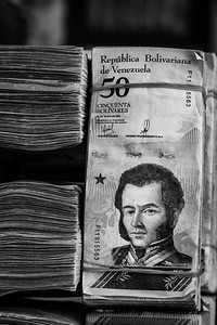 Venezuelan money for sale, nobody takes care of it and nobody steals it because it is very devalued. Packages like this one are seen along the street that connects to the border bridge of Puerto Santander, Colombia. Photo: Dany Krom.