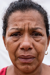 """Woman cries while she tells how sad it has been to leave her country. In the invasions """"Brisas de Paz y Futuro"""" and """"Alfonso Gómez"""" live around 300 Venezuelan families who occupy these lands illegally where they build their houses of materials that they get at very low cost."""