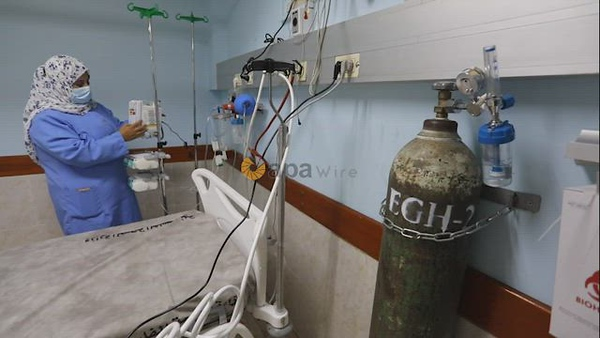 Palestinian medical workers inspect the COVID-19 intensive care unit at European Gaza Hospital