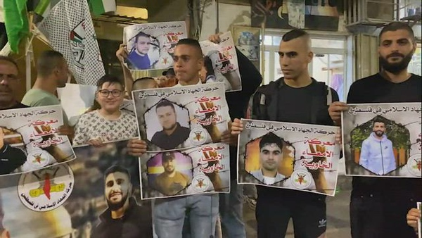 Palestinians take part in a protest in solidarity with prisoners on hunger strike held at Israeli Jails