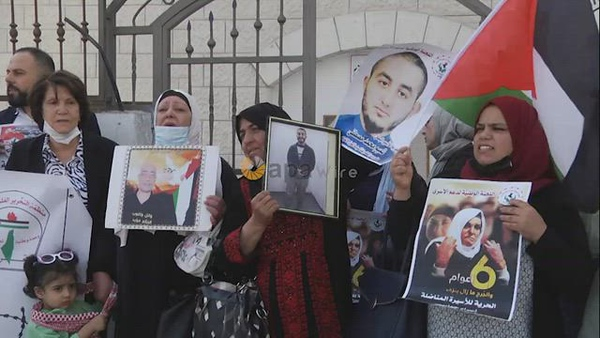 Palestinians take part in a protest in solidarity with prisoners on hunger strike in israeli jails