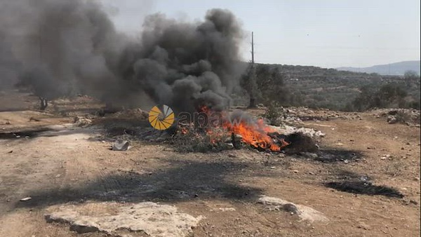 Palestinian protesters clash with Israeli troops during a demonstration against settlements in the village of Beita