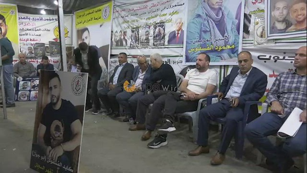 Palestinians take part in a protest in solidarity with prisoners on hunger strike