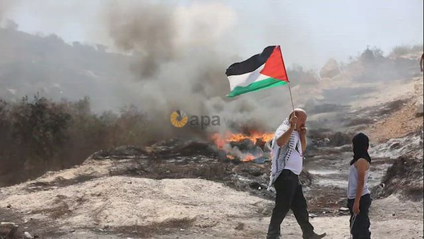 Palestinian protesters clash with Israeli security forces following a demonstration against settlements in the West Bank village of Beita