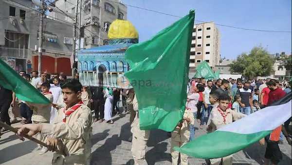 Palestinians take part in a rally on 10th anniversary of prisoners swap deal between Hamas and Israel