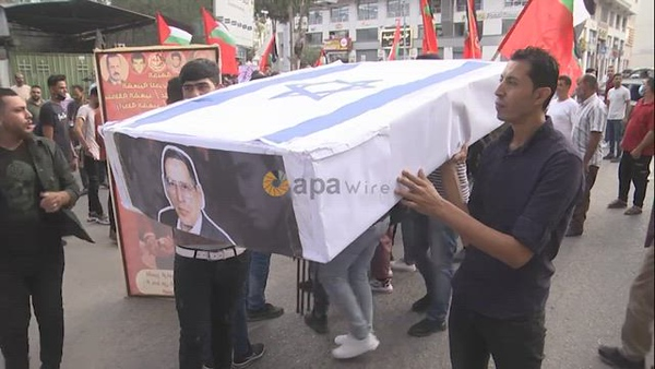 Palestinian supporters of the Popular Front for the Liberation of Palestine take part in a protest on the anniversary of the17th of October