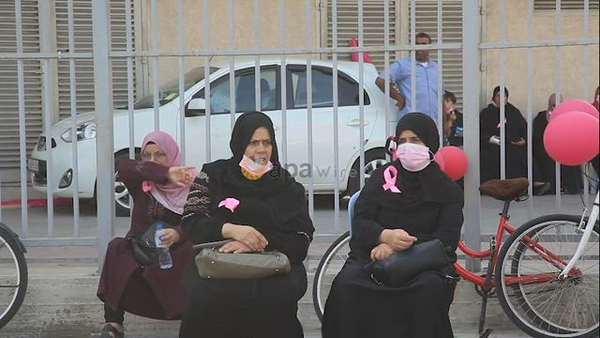 Palestinian women participate in pink sports entertainment day to raise awareness for early breast cancer screening