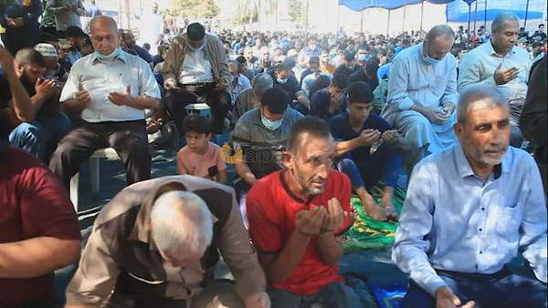 Palestinians attend Friday prayer in front of Red cross office in solidarity with prisoners on hunger strike held at Israeli Jails