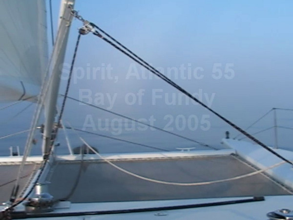 A55, Spirit, sailing well in light winds. Although the mystery is why the sea surface was so glassy.