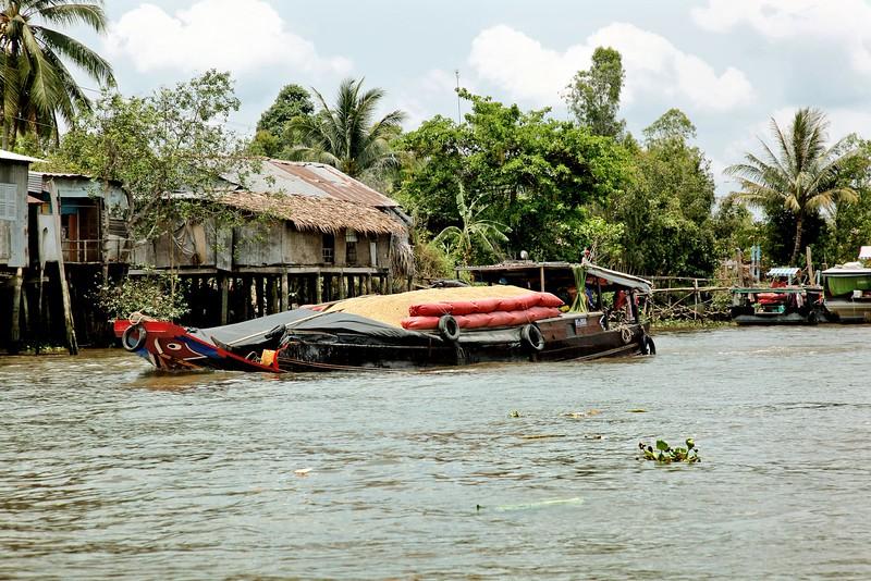 MEKONG DELTA, Boat full of rice