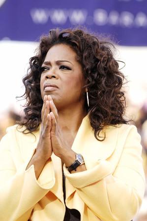 Barack Obama & Oprah Winfrey welocme everyone to Williams Brice Stadium in Columbia South Carolina on Sunday December 09, 2007. Valerie Goodloe