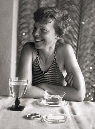"In this January 1935 photo provided by Matson Navigation Company Archives, Amelia Earhart is seen relaxing in a swimsuit at The Royal Hawaiian Hotel in Honolulu, Hawaii. The historic Waikiki hotel is hosting an exhibition of rarely seen photographs taken of the pioneering aviator when she visited Hawaii and stayed at the ""Pink Palace of the Pacific"" during the 1930s. (AP Photo/Matson Navigation Company Archives) NO SALES"