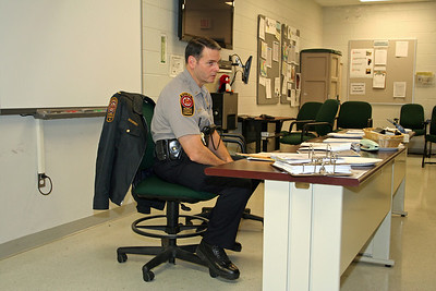 Lt Dennis O'Neill holds role call.