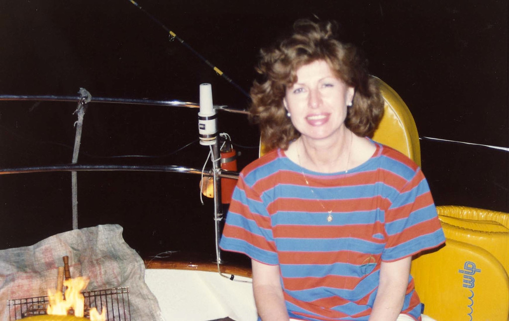 Betty helping with dinner trip to Virgin Islands aboard the Natasha, March 18-25, 1989