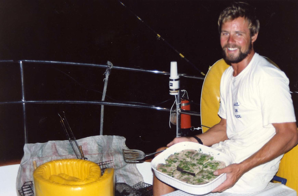 Nigel preparing BBQ dinner on the back of the ship trip to Virgin Islands aboard the Natasha, March 18-25, 1989
