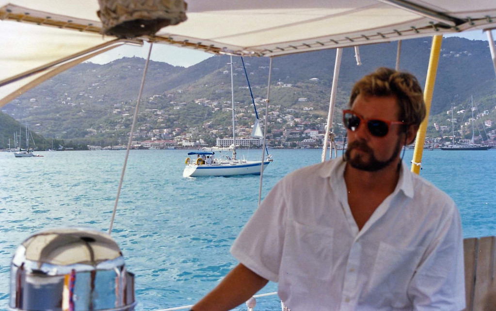 Captain Nigel at the helm trip to Virgin Islands aboard the Natasha, March 18-25, 1989