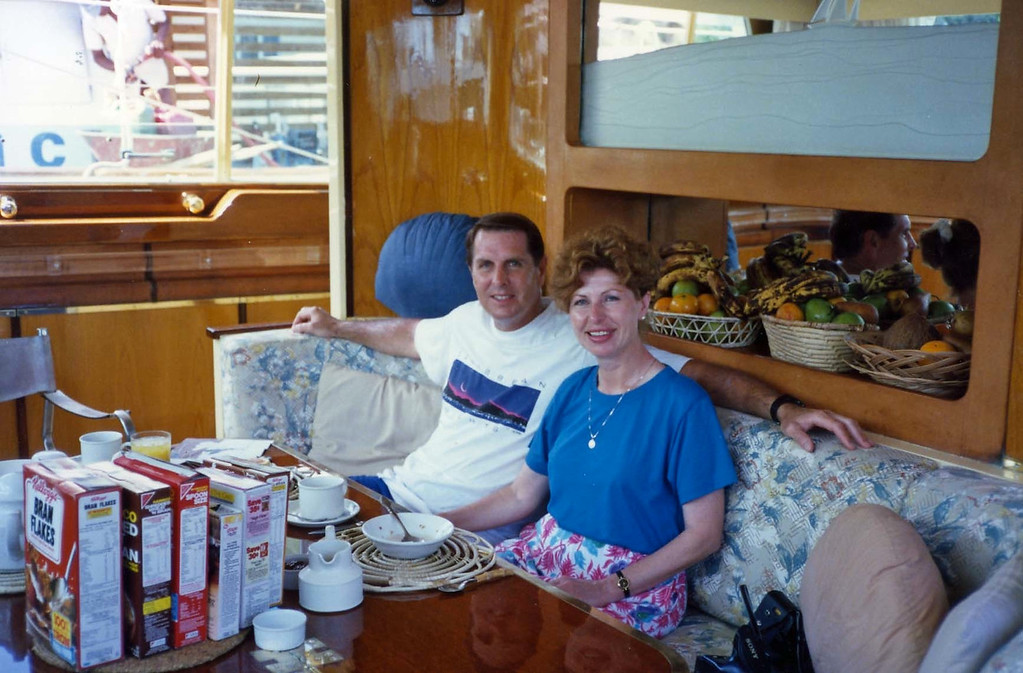 Relaxing after breakfast trip to Virgin Islands aboard the Natasha, March 18-25, 1989