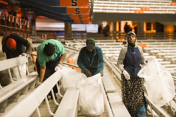 Refugees cleaning up the dome after the event.