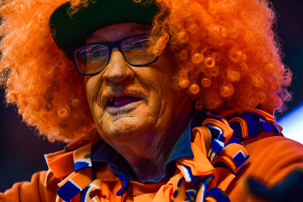 Syracuse super fan cheers on the Orange at the football game.