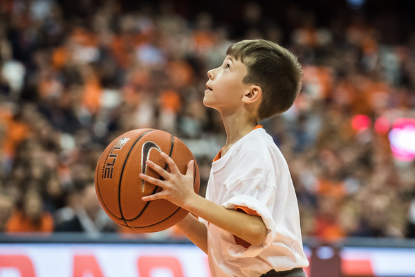 Young Syracuse fan beats all of the basketball team in a skills challenge.