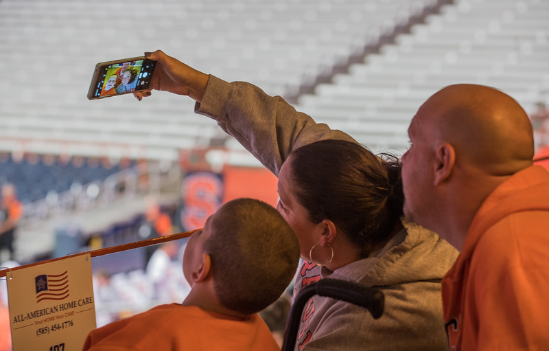 Syracuse fans take a family selfie.