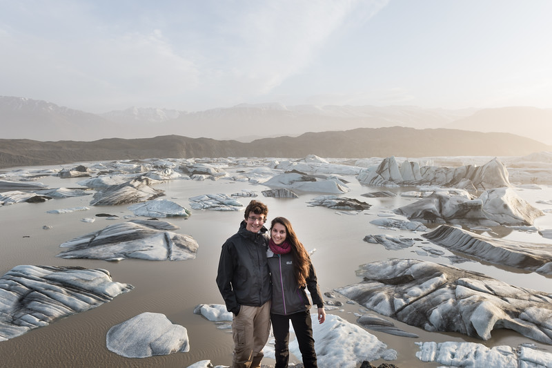 Young couple standing in front of the Hoffellsjökull glacier in Iceland during sunset