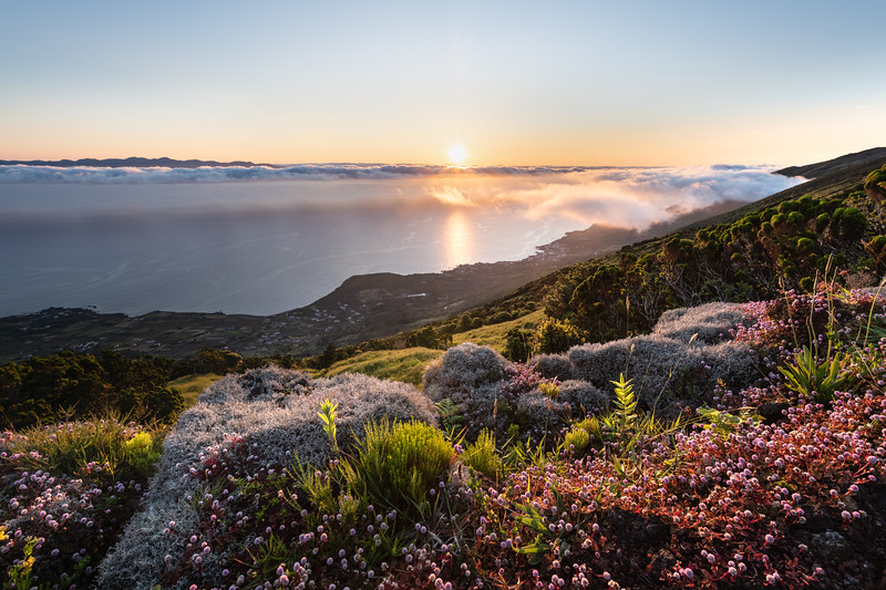 Sunrise landscape at the northeast coast of Pico Island, Ilha do Pico, with Sao Jorge Island in the background and the coastline with Prainha do Baixo,  Canto da Areia, Santo Amaro, and Terra alta.