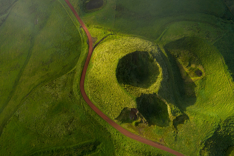 Top view of a volcanic crater on Pico island short after sunrise