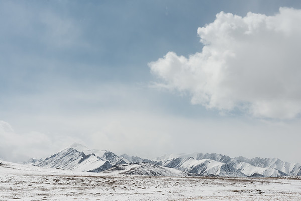 Snowed landscape with mountains at the Barskoon mountain range in Kyrgyzstan all together creating a very peaceful atmosphere.