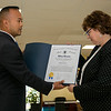 Visiting Nurse Association (VNA) held a centennial celebration at the Leominster Senior Center on Wednesday, September 25, 2019. Senator Dean Tran gives a citation from the Senate to Holly Chaffee the President and CEO of CNA at the event. SENTINEL & ENTERPRISE/JOHN LOVE