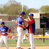 St. Clair starting pitcher Max Gottler (11) shakes hands with head coach Denny White after being removed from the game in the fifth inning Thursday. Gottler went 4 2/3, helping the Saints to a 9-1 victory. (MIPrepZone photo galley by Randy Castro)