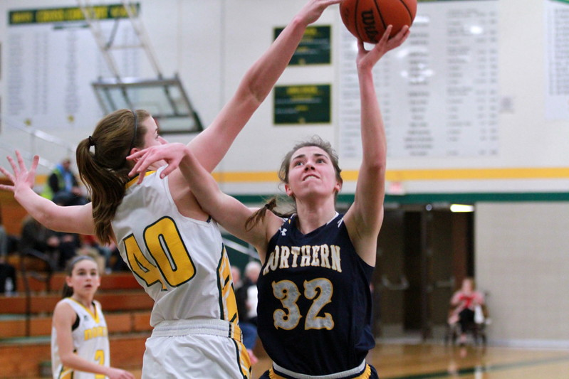 Port Huron Northern's Bree Bauer (32) puts up a shot in the first quarter of a game against Grosse Pointe North Thursday, Jan. 12. (MIPrepZone photo gallery by Randy Castro)