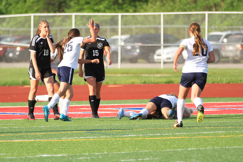 Richmond players mob teammate Grace Aiken (2) after scoring a goal with 17.1 seconds left in the second overtime period of a District 43 quarterfinal at Marine City Tuesday, May 30. (MIPrepZone photo gallery by Randy Castro)