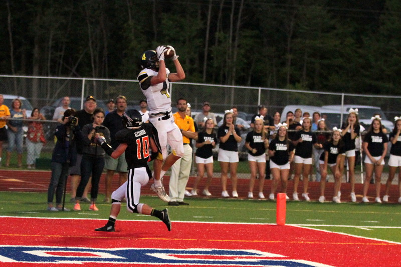 Algonac's Nick Flokerts (4) hauls in a 10-yard touchdown reception for the game's only offensive score. The Muskrats topped the Marine City Mariners 7-2 Thursday, Aug. 25. (MIPrepZone photo gallery by Randy Castro)