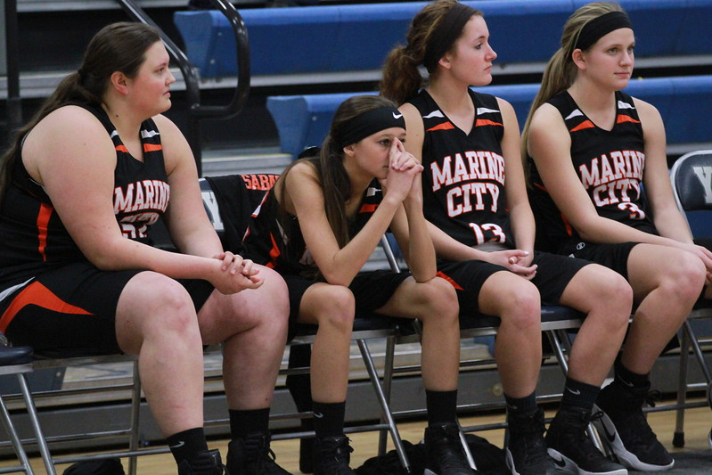 Players on the Marine City bench watch during the final minute of a Region 14 semifinal loss to Goodrich Tuesday, March 7. (MIPrepZone photo gallery by Randy Castro)