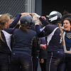 Marysville players mob teammate Anna Herr after a fourth-inning home run Tuesday, May 2. (MIPrepZone photo gallery by Randy Castro)