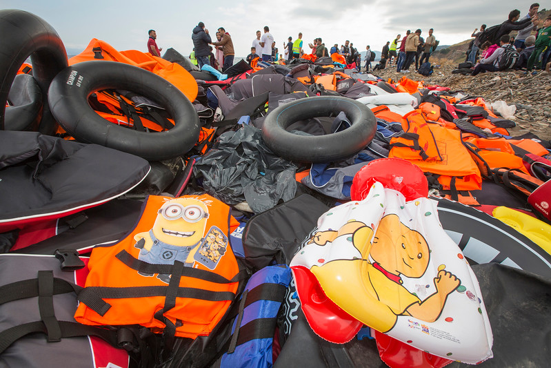 Syrian migrants landing on the north coast of Lesvos at Efthalou, surrounded by a sea of abandoned life jackets.