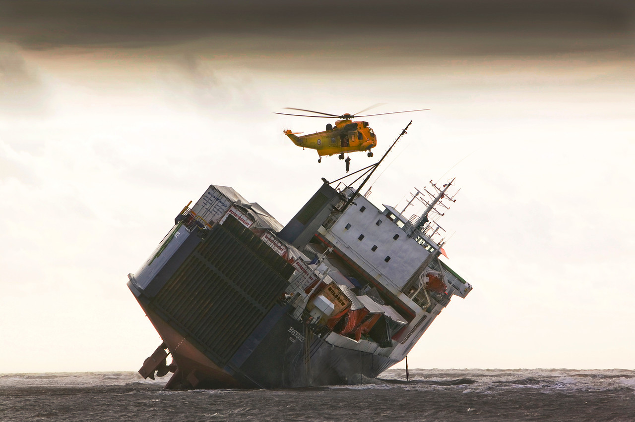 An RAF Sea King Helicopter prepares to drop salvage experts onto the Riverdance washed ashore off Blackpool.