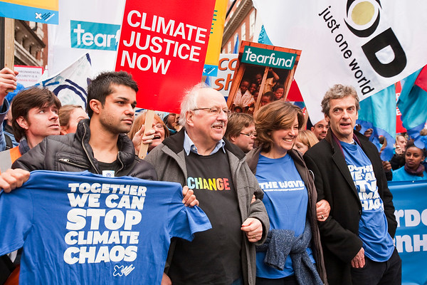 Celebrities including the actor Peter Capaldi and the former BBC weatherman Michael Fish join the Wave climate change protest rally in London.
