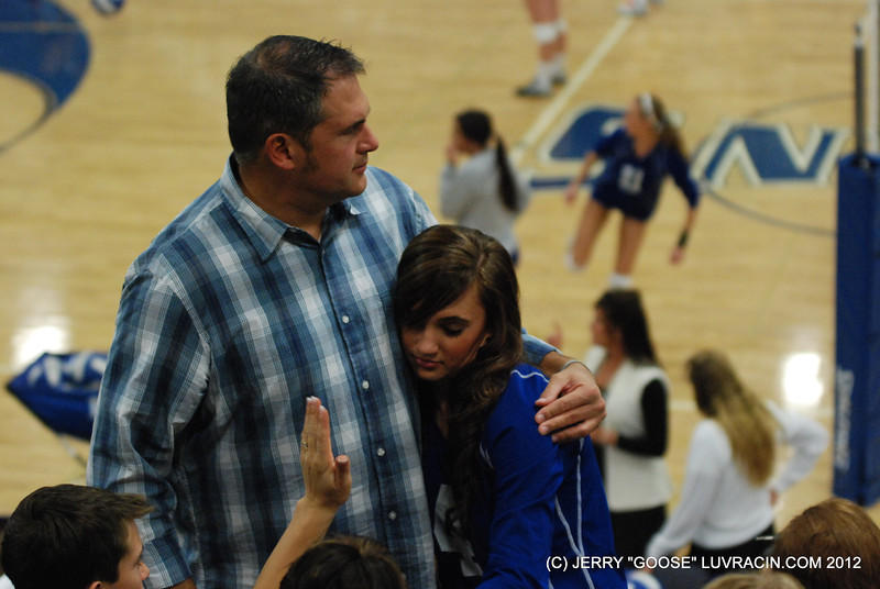 DAD GIVES DAUGHTER COMFORT.