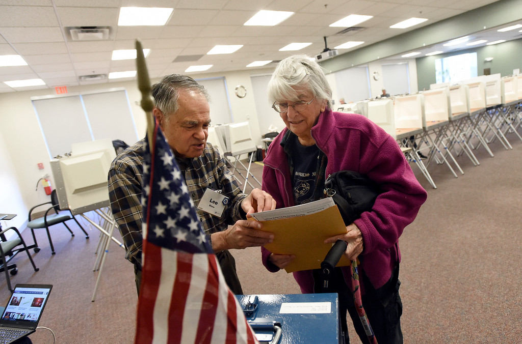 . BOULDER, CO - NOVEMBER 5, 2018: Boulder COunty Elections worker Lee Shaw, left, helps Lesley Julian, of Louisville, with her ballot on Monday at the Boulder County Clerk and Recorder\'s Office in Boulder. For more photos of people voting go to dailycamera.com (Photo by Jeremy Papasso/Staff Photographer)