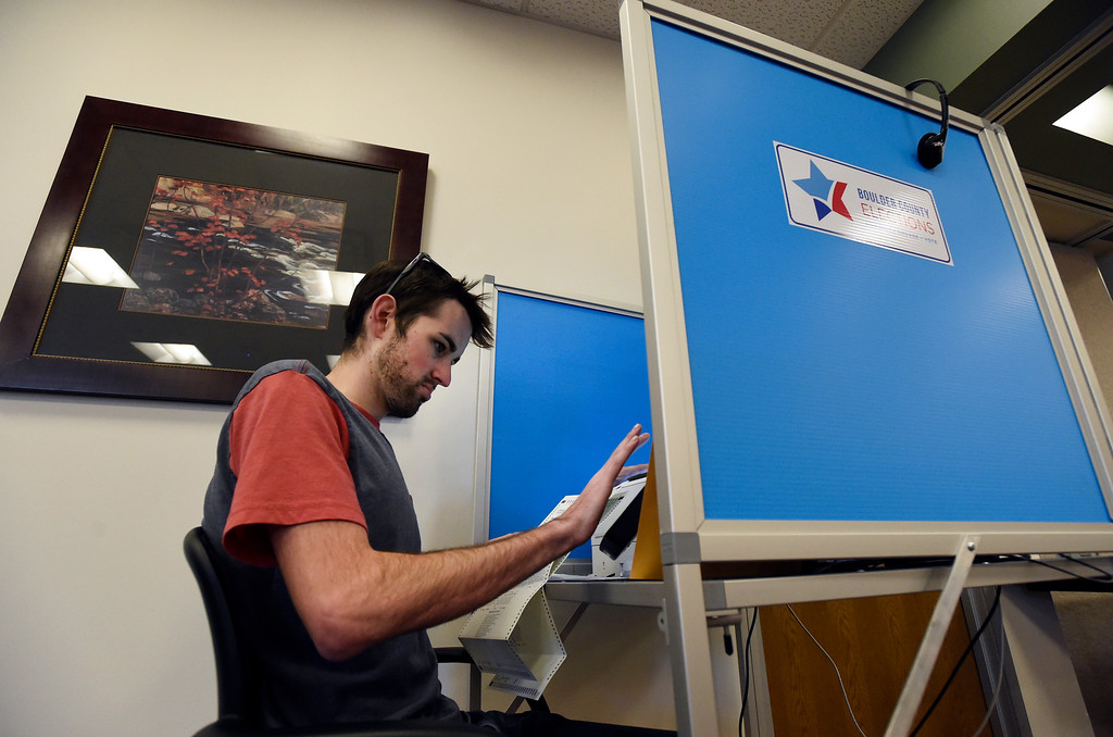 . BOULDER, CO - NOVEMBER 5, 2018: Wyatt Svarczkopf, of Boulder, fills out his ballot electronically while voting on Monday at the Boulder County Clerk and Recorder\'s Office in Boulder. For more photos of people voting go to dailycamera.com (Photo by Jeremy Papasso/Staff Photographer)