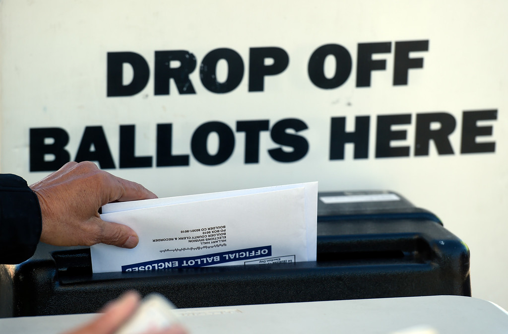 . BOULDER, CO - NOVEMBER 5, 2018: Boulder County Elections worker Richard Gerson places ballots in a secured box  on Monday outside of the Boulder County Clerk and Recorder\'s Office in Boulder. For more photos of people voting go to dailycamera.com (Photo by Jeremy Papasso/Staff Photographer)