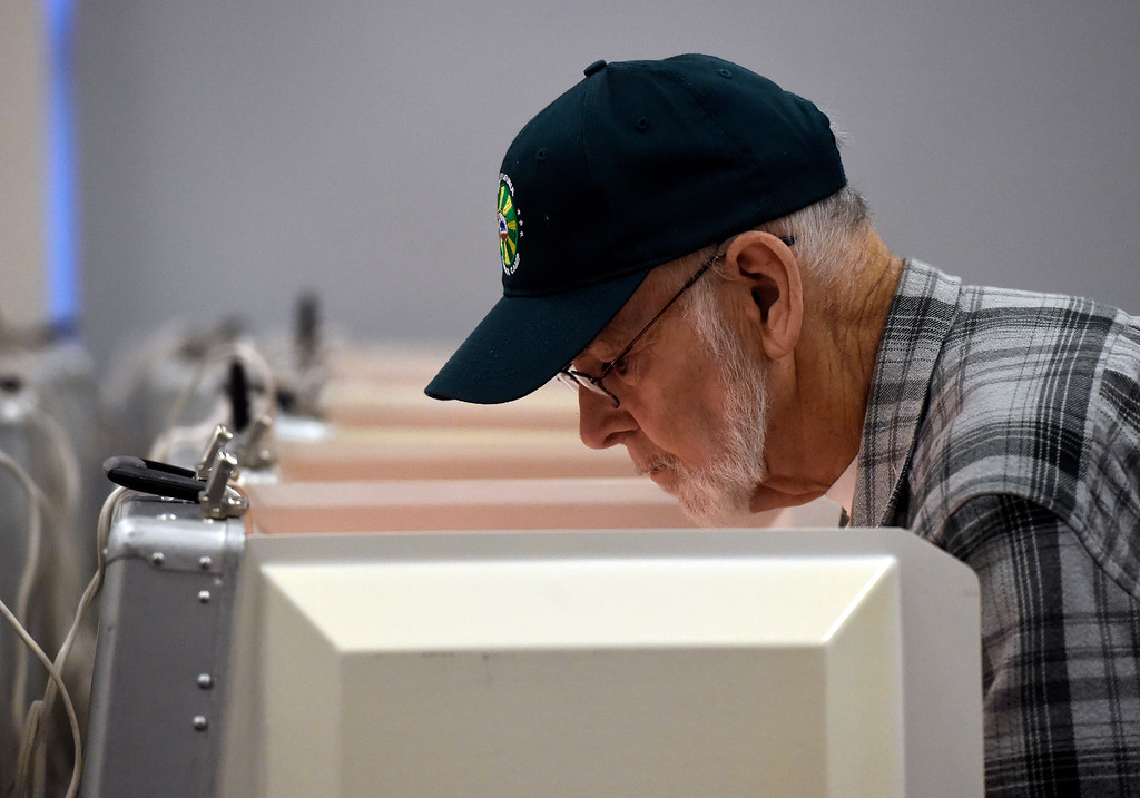. BOULDER, CO - NOVEMBER 5, 2018: Ron Farina, of Boulder, fills out his ballot while voting on Monday at the Boulder County Clerk and Recorder\'s Office in Boulder. For more photos of people voting go to dailycamera.com (Photo by Jeremy Papasso/Staff Photographer)