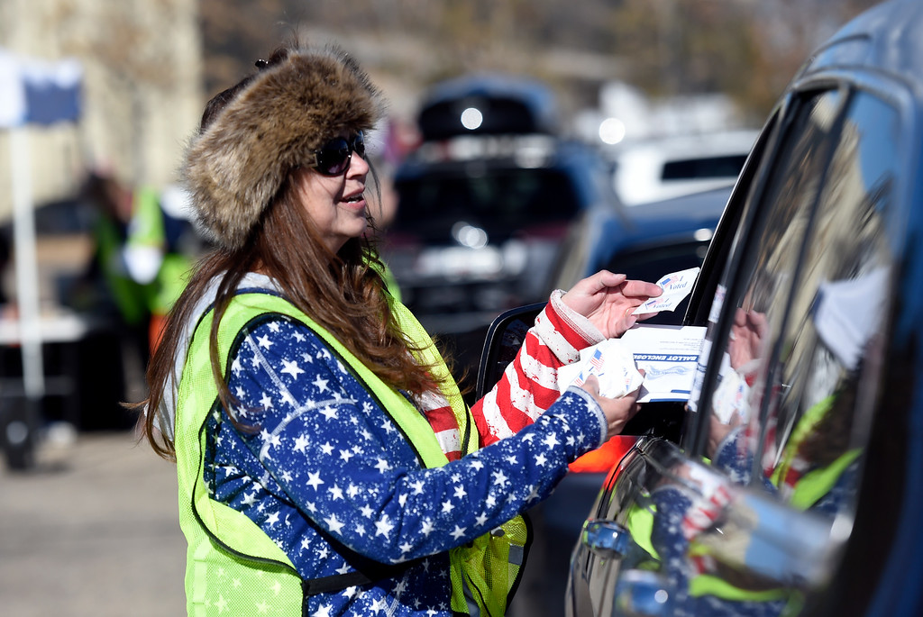 . BOULDER, CO - NOVEMBER 5, 2018: Boulder County Elections worker Carrie Ann Collins takes a ballot from a resident on Monday outside of the Boulder County Clerk and Recorder\'s Office in Boulder. For more photos of people voting go to dailycamera.com (Photo by Jeremy Papasso/Staff Photographer)