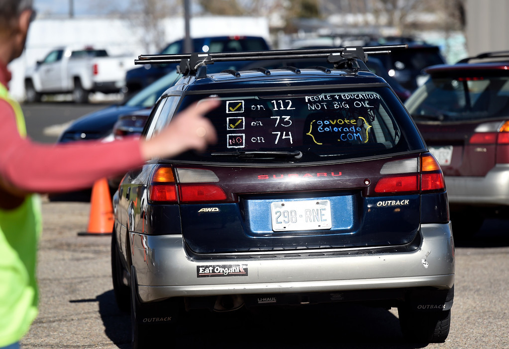 . BOULDER, CO - NOVEMBER 5, 2018: A car is seen with propaganda after the person voted on Monday outside of the Boulder County Clerk and Recorder\'s Office in Boulder. For more photos of people voting go to dailycamera.com (Photo by Jeremy Papasso/Staff Photographer)